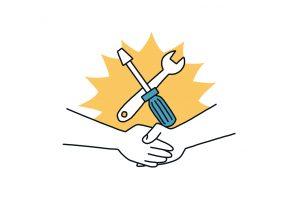 Zwei Hände schlagen ein, Werkzeuge im Hintergrund.